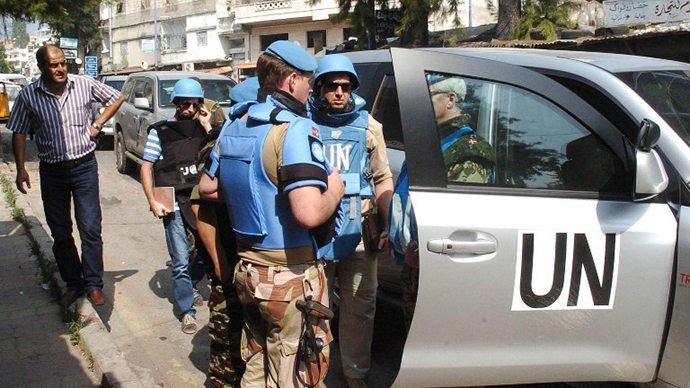 A team of United Nations observers touring the Syrian town of al-Haffe in the Mediterranean province of Latakia (file photo) (AFP Photo / SANA)