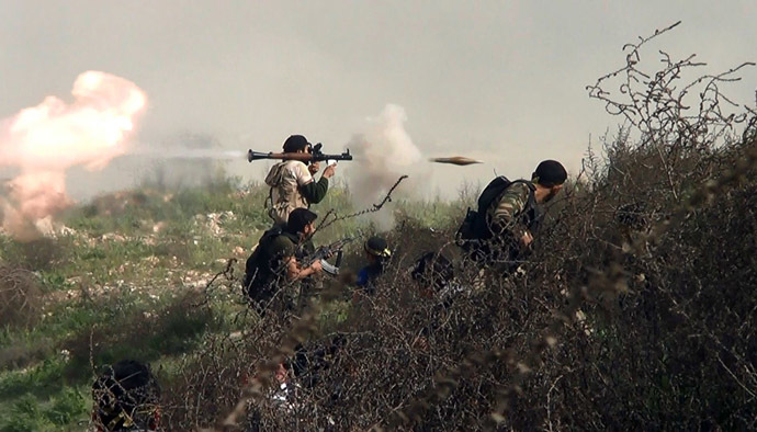 An image grab taken from a video shows an opposition fighter firing an rocket propelled grenade (RPG) on August 26, 2013 during clashes with regime forces over the strategic area of Khanasser, situated on the only road linking Aleppo to central Syria. (AFP Photo)