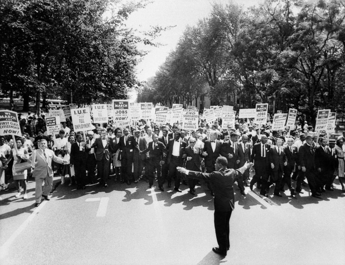 "he clergyman and civil rights leader Martin Luther KIng (C) and other black and white civil right leaders march 28 August 1963 on the Mall in Washington DC during the ""March on Washington"". (AFP Photo)"