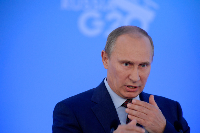 Russia's President Vladimir Putin gestures during a press conference at the end of the G20 summit on September 6, 2013 in Saint Petersburg (AFP Photo / Alexandr Nemenov)