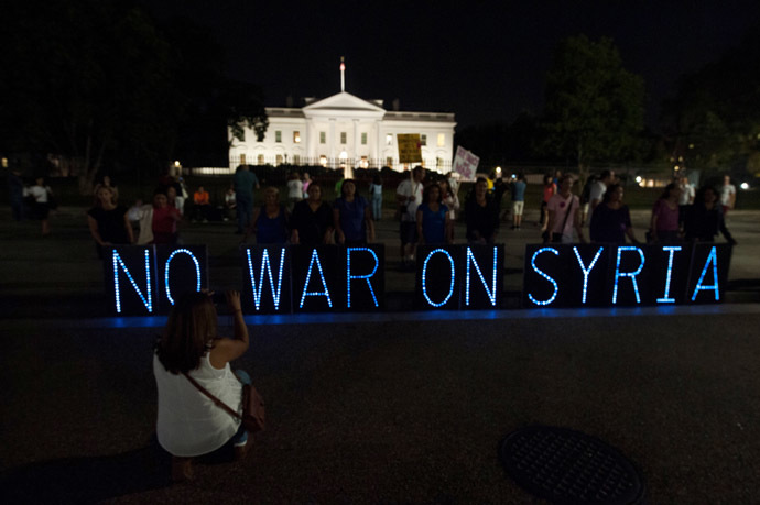 Anti-war demonstrators protest against US intervention in Syria in front of the White House in Washington on September 10, 2013 before US President Brack Obama addresses the nation on Syria. (AFP Photo/Nicholas Kamm)