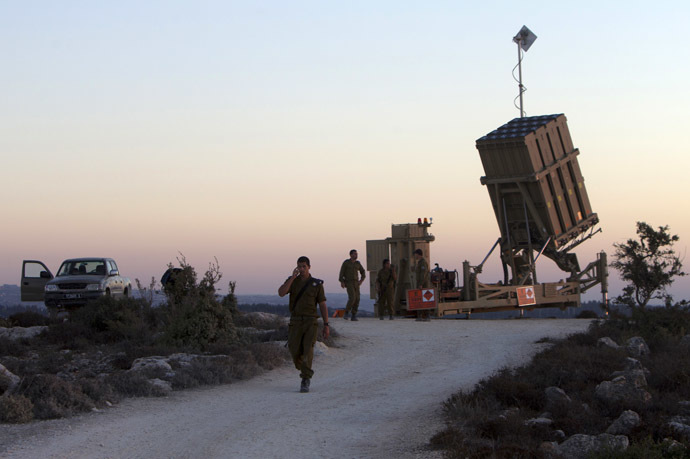 "Israeli soldiers stand near an ""Iron Dome"" battery, a short-range missile defence system, designed to intercept and destroy incoming short-range rockets and artillery shells, near Jerusalem on September 8, 2013 as the United States lobbied for domestic and international support for military strikes against Syria. (AFP Photo)"