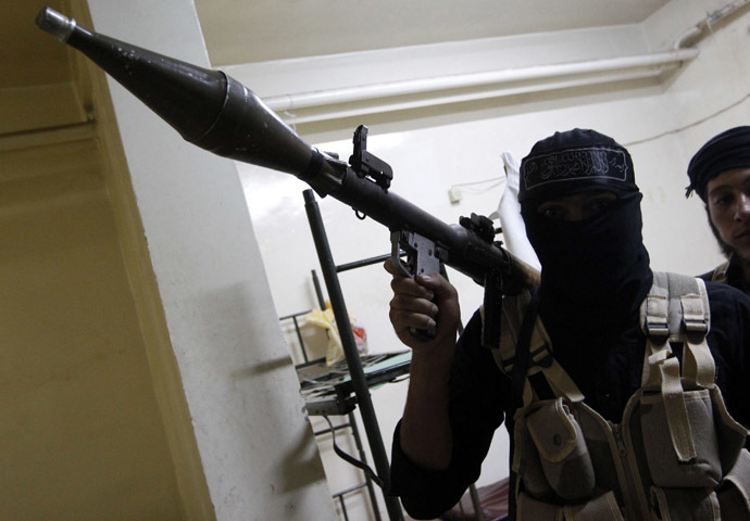A Free Syrian Army fighter poses for a picture as he holds an RPG launcher in Raqqa province, eastern Syria September 4, 2013. (Reuters/Nour Fourat)