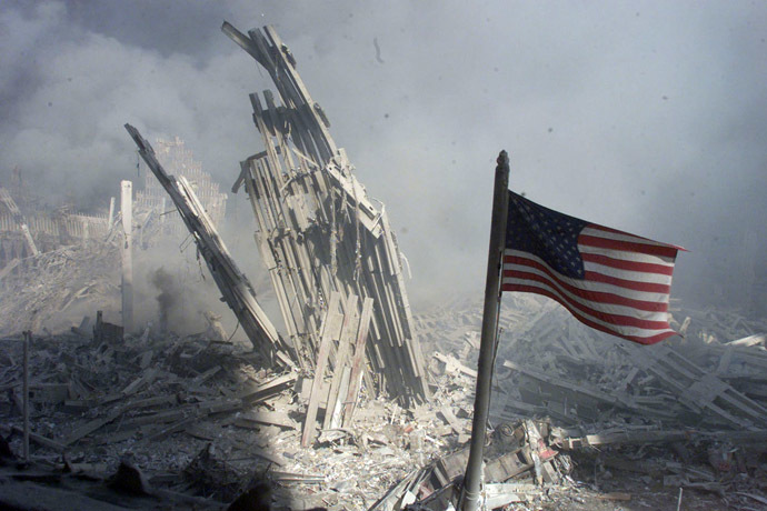 An American flag flies near the base of the destroyed World Trade Center in New York, in this file photo from September 11, 2001, taken after the collapse of the towers. (Reuters/Peter Morgan)