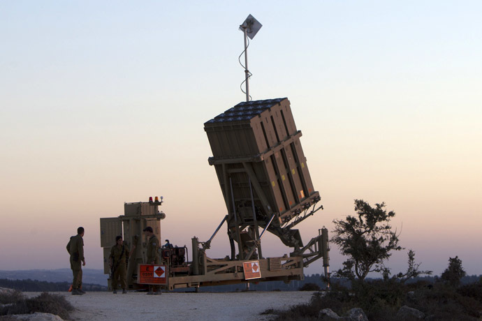 "Israeli soldiers stand near an ""Iron Dome"" battery, a short-range missile defence system, designed to intercept and destroy incoming short-range rockets and artillery shells, near Jerusalem (AFP Photo)"