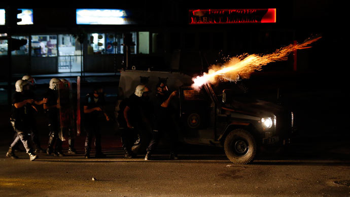 Riot police fire tear gas at protesters during clashes in central Hatay, September 11, 2013. (Reuters / Umit Bektas)