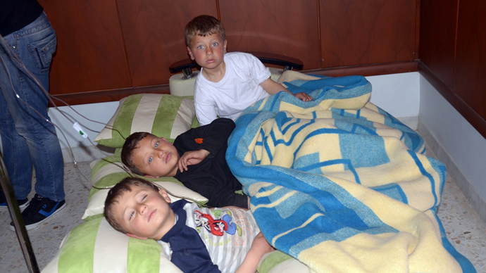 In this image made available by the Syrian News Agency (SANA) on March 19, 2013, three boys rest on cushions laid on the floor of a hospital in the Khan al-Assal region in the northern Aleppo province, as Syria's government accused rebel forces of using chemical weapons for the first time (AFP Photo)