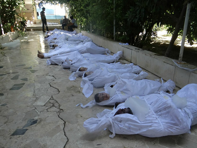 A handout image released by the Syrian opposition's Shaam News Network shows bodies of children wrapped in shrouds as Syrian rebels claim they were killed in a toxic gas attack by pro-government forces in eastern Ghouta, on the outskirts of Damascus on August 21, 2013. (AFP/Shaam News Network)
