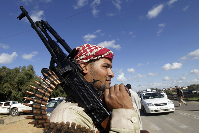 Fighters from Zawiya man a checkpoint at the entrance of the city after clashes between the Warchafana and Zawiya tribes at checkpoint 27 about 27 km west of the capital Tripoli on November 12, 2011. (AFP Photo)