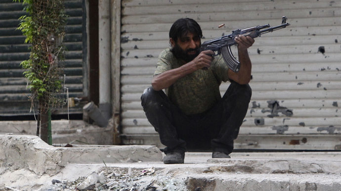 A Free Syrian Army fighter fires his weapon in Ashrafieh, Aleppo, September 18, 2013. (Reuters/Muzaffar Salman)