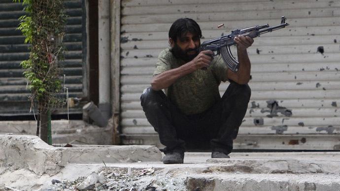 A Free Syrian Army fighter fires his weapon in Ashrafieh, Aleppo, September 18, 2013. (Reuters/Muzaffar Salman)