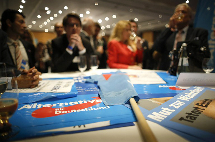 Supporters of the Alternative for Germany party (AfD) celebrates after exit polls are broadcast on television in Berlin on September 22, 2013, after the German general elections. (AFP Photo / Philipp Guelland)