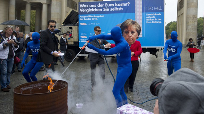 Germany's fledgling anti-euro party Alternative for Germany (Alternative fuer Deutschland, AfD) members play a scene with a person wearing a mask featuring German Chancellor Angela Merkel (C) and AfD members extinguishing a fire set on fake Euro Banknotes during an electoral action in front of the Brandenburg Gate on September 16, 2013 in Berlin, ahead of the General election. (AFP Photo / Barbara Sax)