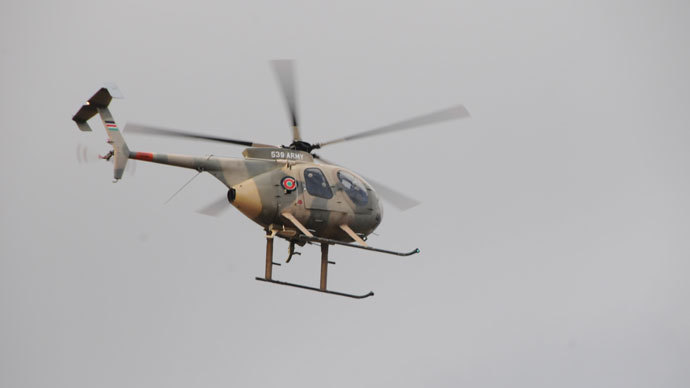 Military helicopter over Westgate. Photo by Andre Vltchek
