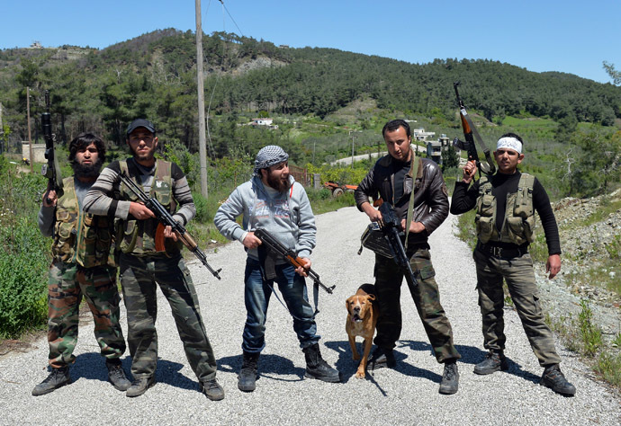 Rebel fighters from the Al-Ezz bin Abdul Salam Brigade pose for picture as they attend a training session at an undisclosed location near the al-Turkman mountains, in Syria's northern Latakia province, on April 24, 2013. (AFP Photo)
