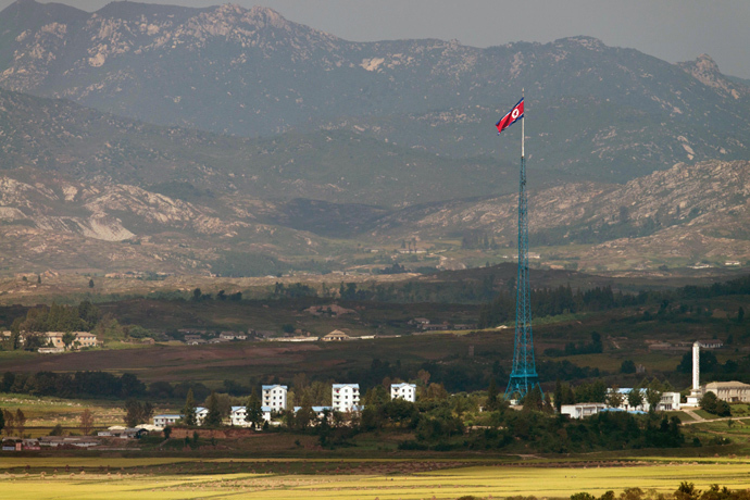 A North Korean flag flutters over North Korea's village of Gijungdong as seen from an observatory point in Paju near the Demilitarized Zone (DMZ) dividing the two Koreas (AFP Photo / Kim Doo-Ho)