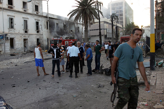 Libyans gather outside a foreign ministry building that was damaged by a powerful blast on September 11, 2013 in the eastern Libyan city of Benghazi (AFP Photo)