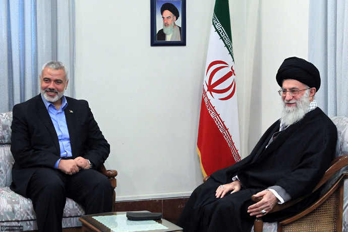 A handout photo provided by Iran's Supreme Leader's office shows Iranian supreme leader Ayatollah Ali Khamenei meeting with Ismail Haniya (L), Palestinian Hamas premier in the Gaza Strip, during a meeting in Tehran on February 12, 2012. (AFP Photo)