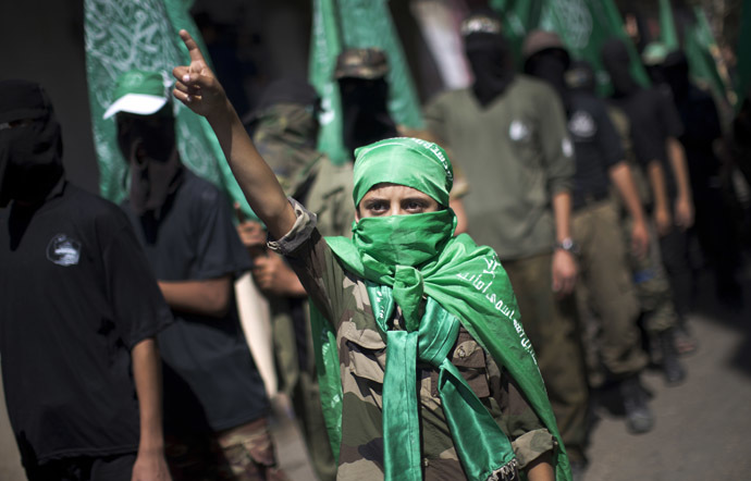 A Palestinian child takes part in a march organised by the ruling Islamic Hamas movement in Gaza's Nusseirat refugee camp on September 27, 2013 in commemoration of the September 28, 2000 outbreak of the devastating second intifada. (AFP Photo)