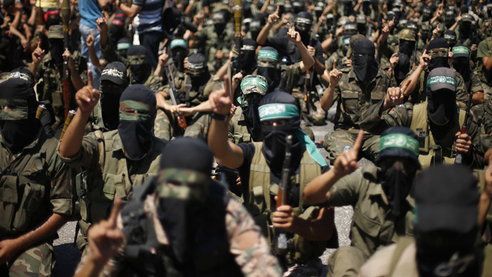 Palestinian militants take part in a protest against peace talks between Israel and the Palestinians, as well as possible U.S. attacks on Syria, in the northern Gaza Strip September 6, 2013. (Reuters)