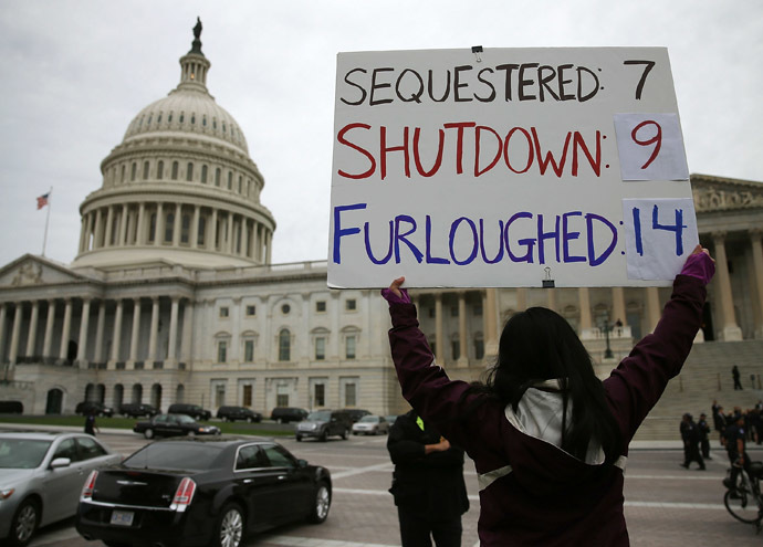 A women holds a sign that reads (Sequestered 7, Shutdown 9, Furloughed 14) during a rally in front of the U.S. Capitol, October 9, 2013 in Washington, DC. (Mark Wilson/Getty Images/AFP)