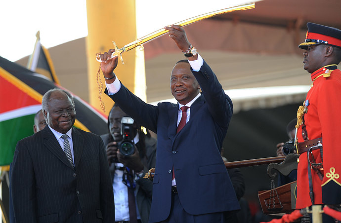 Kenya's fourth president Uhuru Kenyatta receives a sword as a symbol of authority from former president Mwai Kibaki (L) during his inauguration at the Moi International Sports Center Kasarani in Nairobi on April 9, 2013. (AFP Photo/Simon Maina)