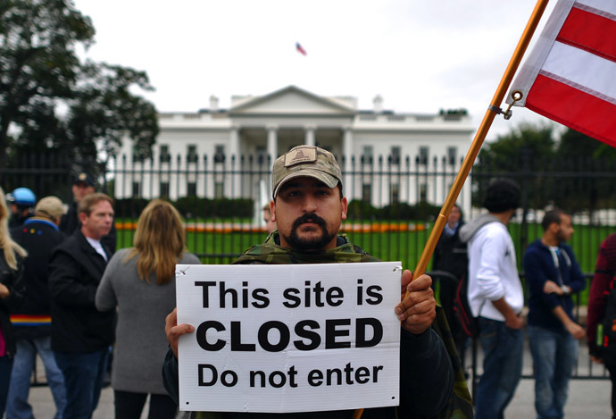 A protester holds a sign during a demonstration in front of the White House in Washington, DC, on October 13, 2013 demanding an end to the US federal government shutdown (AFP Photo/Jewel Samad)