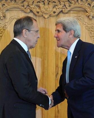 US Secretary of State John Kerry (R) shakes hands with Russian Foreign Minister Sergei Lavrov during their press conference on the sidelines of the APEC Summit in Nusa Dua on Indonesia's resort island of Bali on October 7, 2013 (AFP Photo / Sonny Tumbelaka)