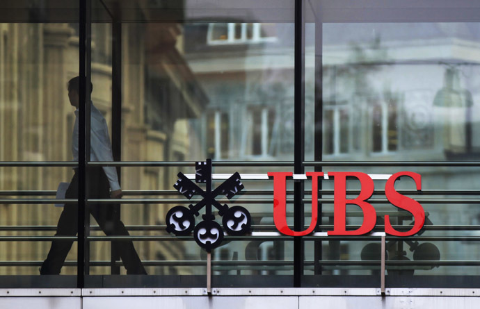 A man walks past a logo of Swiss bank UBS at a building in Zurich (Reuters/Michael Buholzer)