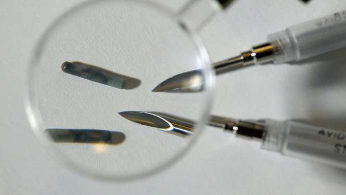 Tiny radio frequency identification (RFID) computer chips with the needles used to implant them under the skin (Reuters)