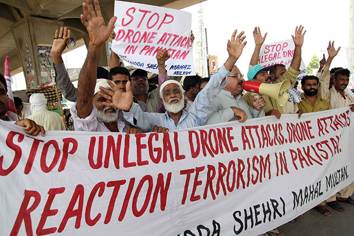 Pakistani protesters from the United Citizen Action shout slogans against US drone attacks in the Pakistani tribal areas during a protest in Multan on July 14, 2013. (AFP Photo / S.S. Mirza)