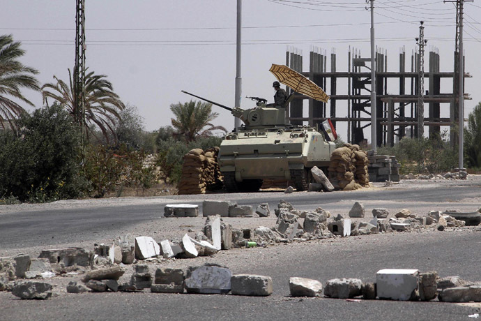 An Egyptian soldier stands guard at a checkpoint in Rafah city on the Egyptian border (Reuters)