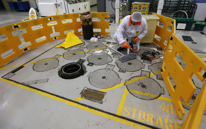 An environmental safety monitor carries out contamination checks in the charge hall inside EDF Energy's Hinkley Point B nuclear power station in Bridgwater, southwest England (Reuters/Suzanne Plunkett)