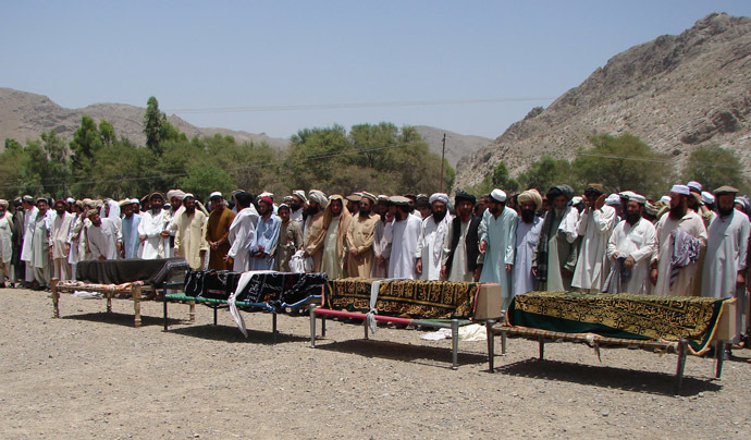 Pakistani tribesmen gather for funeral prayers before the coffins of people allegedly killed in a US drone attack, claiming that innocent civilians were killed during a June 15 strike in the North Waziristan village of Tapi, 10 kilometers away from Miranshah, on June 16, 2011. (AFP Photo)