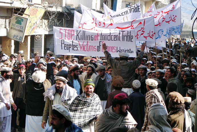 Pakistani tribesmen hold banners as they march during a protest rally against the US drone attacks, in Miranshah, the main town in North Waziristan district on January 21, 2011. (AFP Photo)
