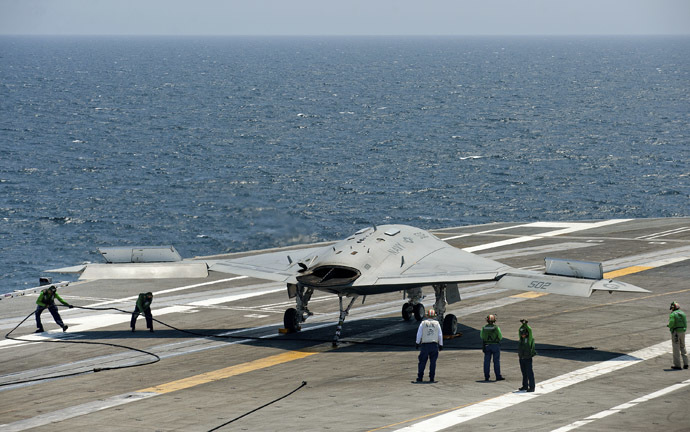 An X-47B pilot-less drone combat aircraft is prepared for launch from the deck of the USS George H. W. Bush aircraft carrier in the Atlantic Ocean off the coast of Norfolk, Virginia, July 10, 2013. (Reuters/Rich-Joseph Facun)