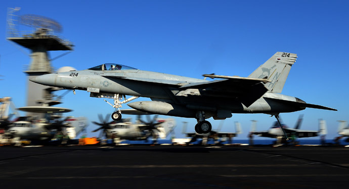 An F/A-18E Super Hornet takes off from the flight deck of the USS Nimitz (CVN 68) aircraft carrier in the Mediterranean Sea on October 24, 2013. The US aircraft carrier, which had been on standby in case of a flare up in Syria, has left the Red Sea for a brief stint in the Mediterranean Sea. (AFP Photo)