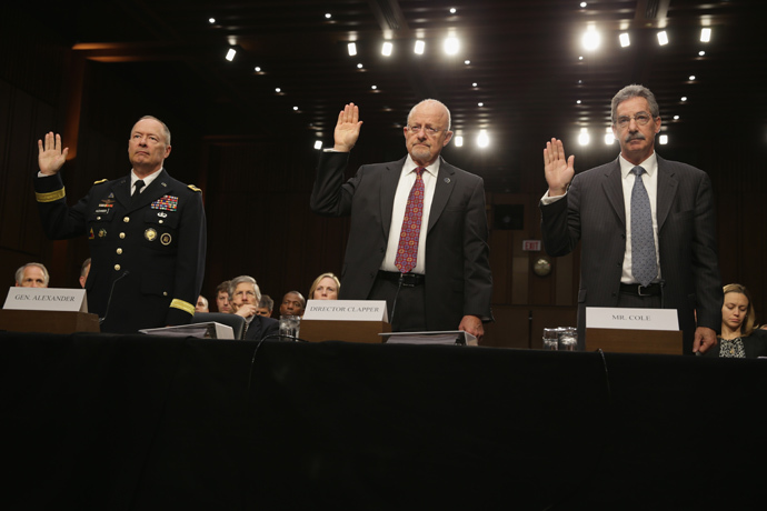 (L-R) National Security Agency Director General Keith Alexander, Director of National Intelligence James Clapper, Deputy Attorney General James Cole are sworn in during a hearing before the Senate (Select) Intelligence Committee September 26,2 103 on Capitol Hill in Washington, DC (Alex Wong / Getty Images / AFP)