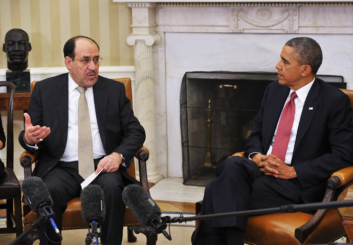 Iraqi Prime Minister Nuri al-Maliki (L) speaks during a meeting with US President Barack Obama during a meeting in the Oval Office of the White House on November 1, 2013 in Washington (AFP Photo / Mandel Ngan)