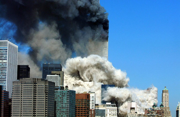 (FILES) This 11 September, 2001 file photo shows smoke billowing up after the first of the two towers of the World Trade Center collapses in New York City. (AFP Photo / Henny Ray Abrams)