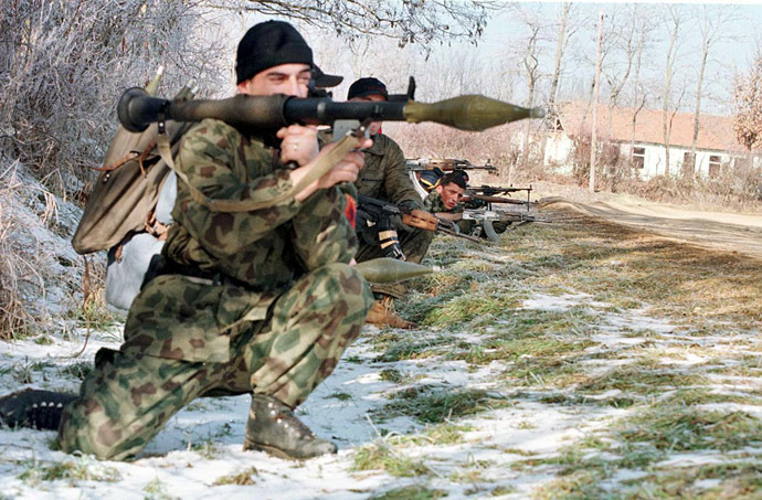 Members of the Kosovo Liberation Army (KLA) man a position on the road near the northern Kosovo village of Llapashtica in the region of Podujevo 26 January 1998 (AFP Photo)