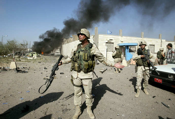 A U.S. soldier directs people outside of the United Nation headquarters in Baghdad August 19, 2003. (Reuters)