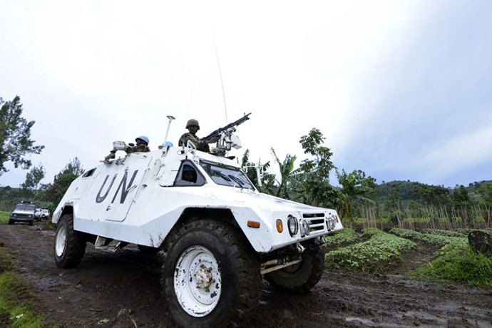 A UN mission in DR Congo (MONUSCO) armored personnel carrier patrols on November 5, 2013 on Chanzu hill, 80 kilometres north of regional capital Goma, in the eastern North Kivu region that was one of the M23 rebels' last stands. (AFP Photo / Junior D. Kannah)