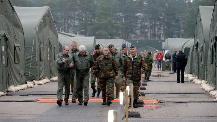 """Military personnel walk in a military base during the """"Steadfast Jazz"""" military exercise in Adazi November 6, 2013. (Reuters / Ints Kalnins)"""