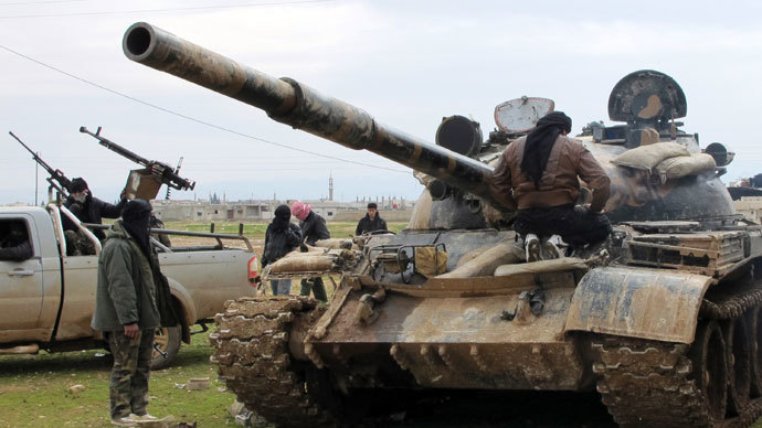 Free Syrian Army fighters look at a tank taken by defectors from the regular Syrian Army in Al Qusayr .(Reuters / Samuel Jamison)