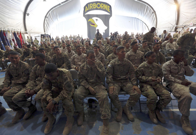 U.S. soldiers attend a naturalization ceremony while celebrating Fourth of July at Bagram airbase, north of Kabul, July 4, 2013. (Reuters/Omar Sobhani)