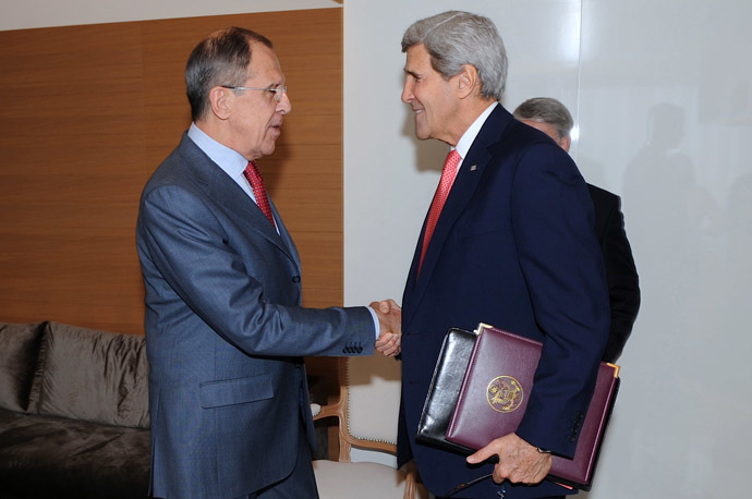 In this image released by the US State Department, US Secretary of State John Kerry (R) shakes hands with Russian Foreign Minister Sergey Lavrov before a bilateral meeting on the margins of talks focused on Iran's nuclear capabilities, Geneva, Switzerland, on November 23, 2013. (AFP/US State Department)
