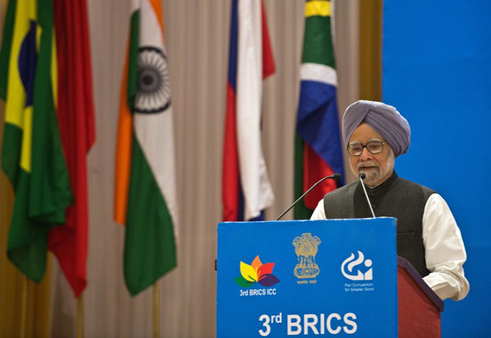Indian Prime Minister Manmohan Singh delivers a speech during the inauguration of the 3rd BRICS International Competition Conference in New Delhi on November 21, 2013. (AFP Photo / Prakash Singh)