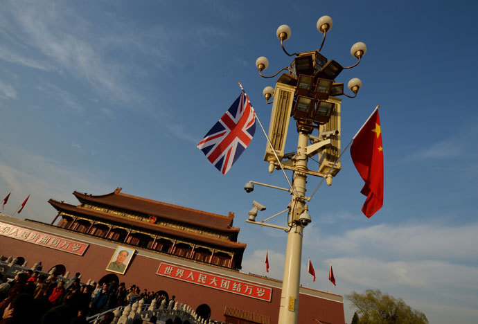 A British and a Chinise flag are displayed near the portrait of late Chinese leader Mao Zedong at Tiananmen Square in Beijing December 2, 2013.(AFP Photo / /Mark Ralston)