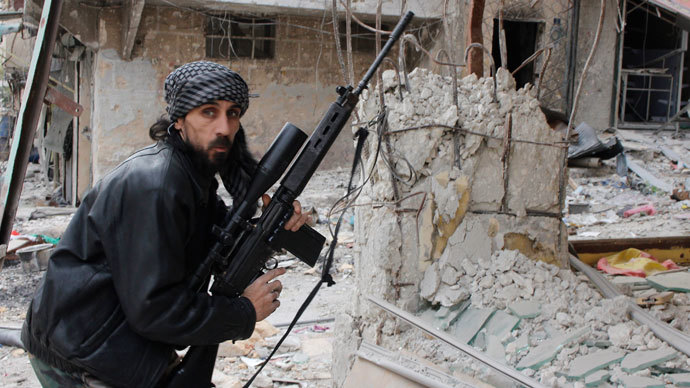 A rebel fighter from the Free Syrian Army holds a position with a Belgium made FAL rifle at a front line in the Salah al-Din neighbourhood of the northern Syrian city of Aleppo, on December 1, 2013.(AFP Photo / Mohammed Al-Khatieb)
